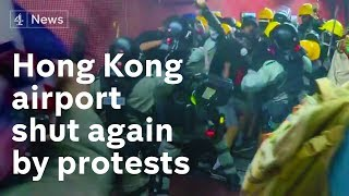 Hong Kong: Violent clashes paralyse airport for second day