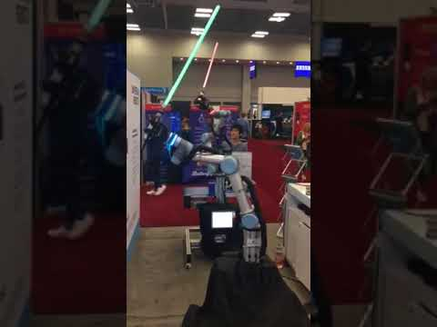Two force-controlled UR5 cobots in Jedi Battle at SXSW