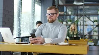 Smiling Businessman Texting on Smartphone in Coffeeshop | Stock Footage - Videohive