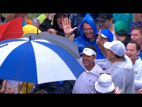 Rich Beem celebrates with the fans at PGA Championship