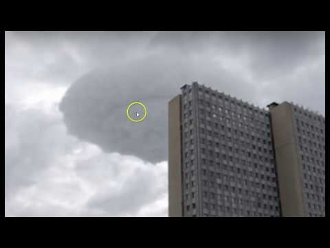 Strange UFO Shaped Cloud Drifts Over Moscow with No Changes In Shape
