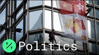 'French Spider-Man' Climbs Hong Kong Skyscraper, Hangs Peace Flag