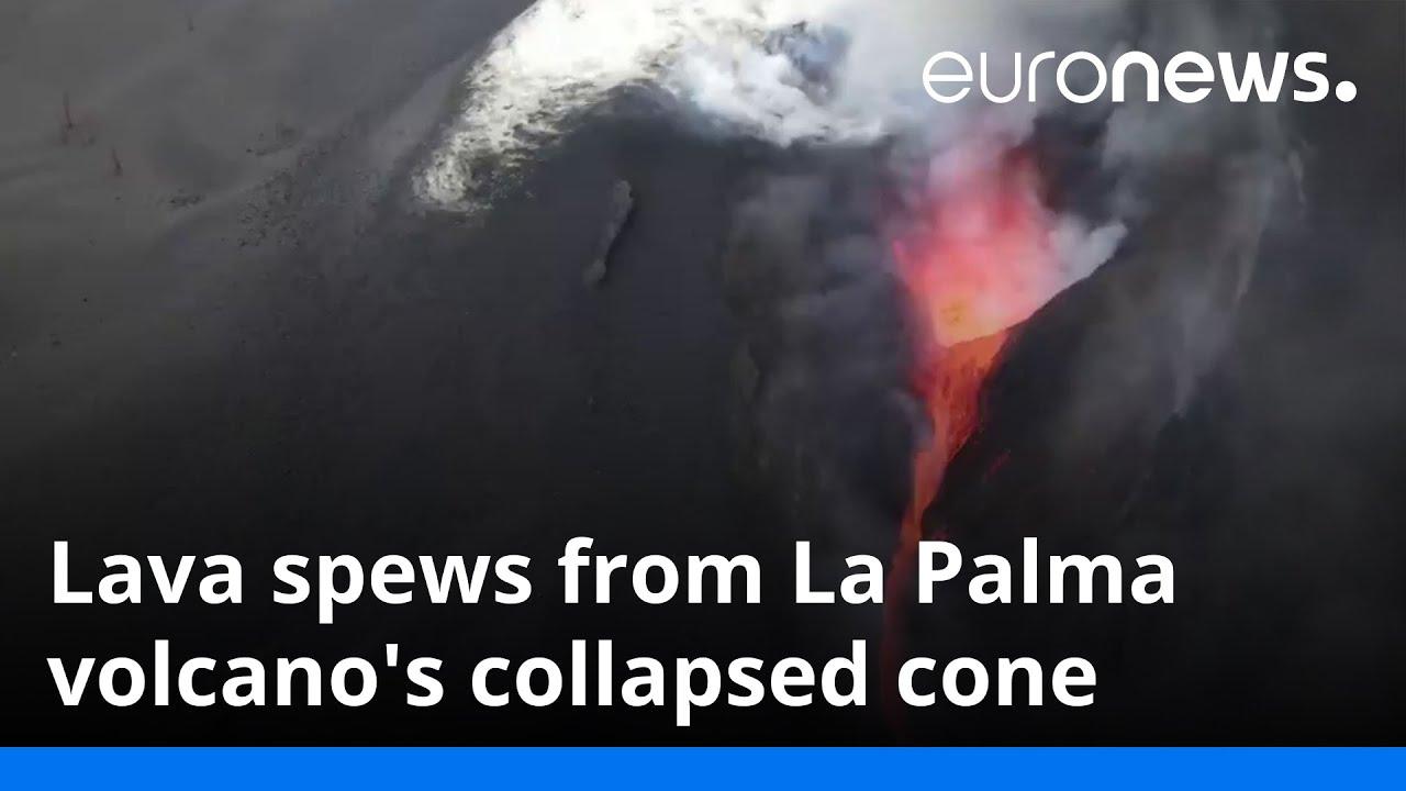 Lava spews from La Palma volcano's collapsed cone