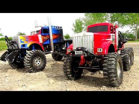 WHO CAN PULL MORE?! OPTiMUS vs BiG RED - iNSANE 6X6 RC TRUCKS Battle THE JUDGE | RC ADVENTURES - UCxcjVHL-2o3D6Q9esu05a1Q