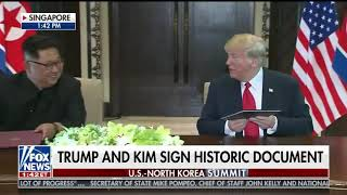 Donald Trump and Kim Jong Un Sign