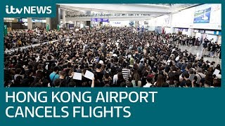 Hong Kong airport grounds all flights as protests continue | ITV News