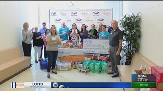 Arvest Bank employees make a donation to Bright Futures Joplin