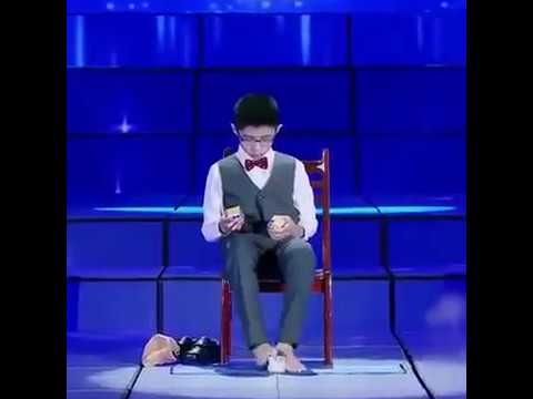 This Boy Solve Three Rubik's Cubes Using Hands And Feet At The Same Time