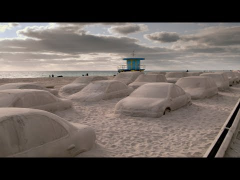 Artist Leandro Erlich creates sand-covered traffic jam on Miami beach