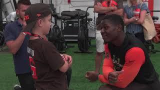 Browns DB T.J. Carrie enjoys a conversation with Junior Reporter CJ DeJohn