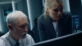 Female Manager Talks with Professional Operator Working on a Personal Computer in the System Room |