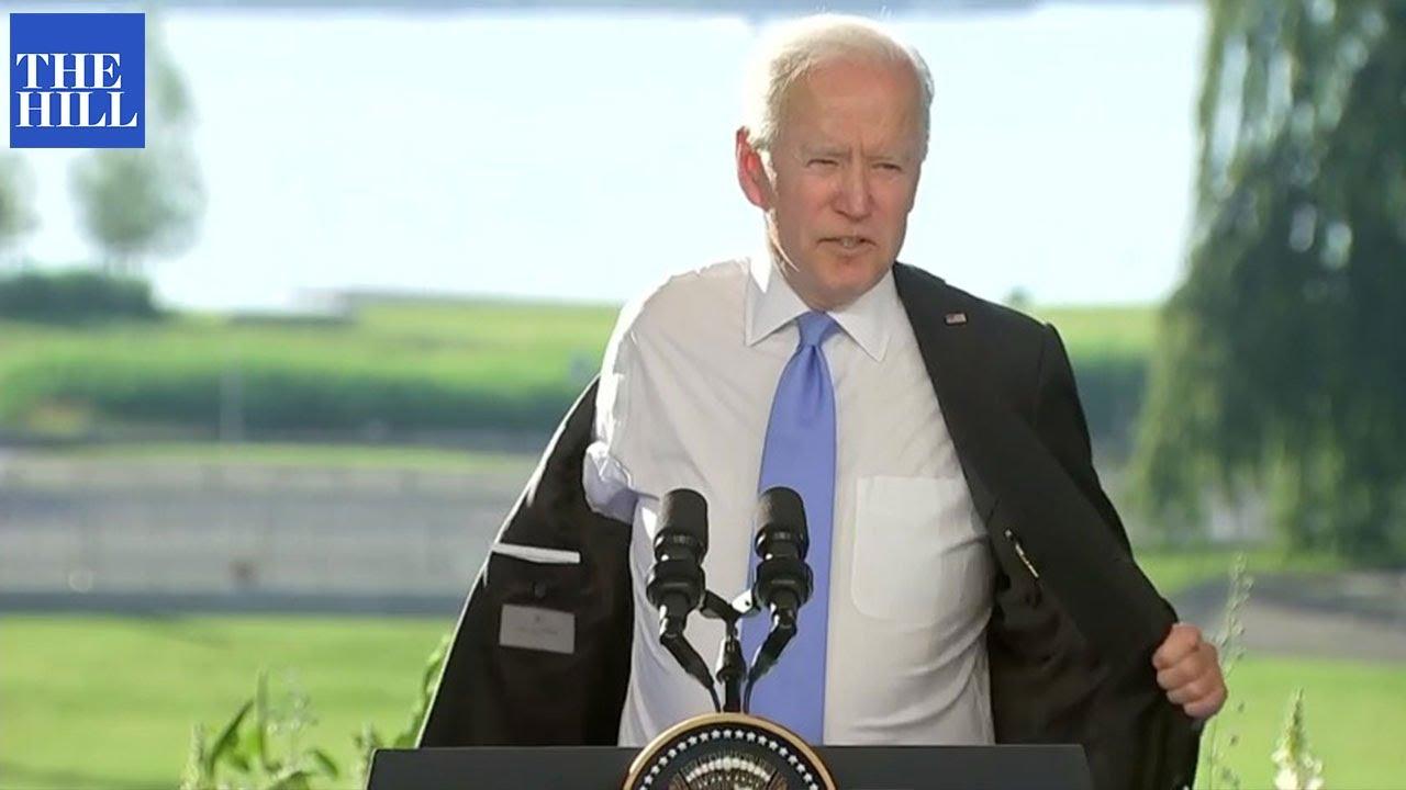 Biden removes jacket due to heat
