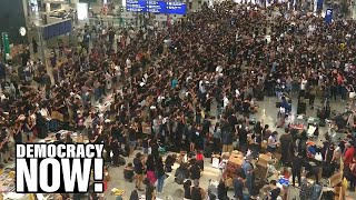 Hong Kong Grounds Flights as Mass Sit-in Shuts Down Airport After Weekend of Protests