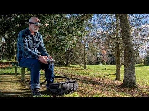 Old man walks, talks and flies a drone in the park - UCQ2sg7vS7JkxKwtZuFZzn-g