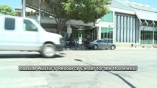 Downtown businesses hand out bottles of water for the homeless in Austin