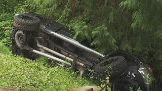 Driver trapped in car that flipped into Ash Creek