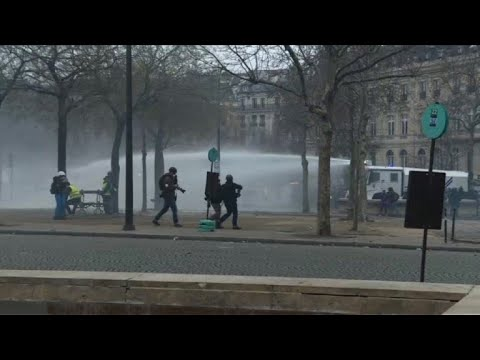 Clashes erupt as France's 'yellow vests' stage fresh protests