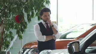 Young Handsome Businessman Examining Cars for Sale at the Dealership | Stock Footage - Videohive