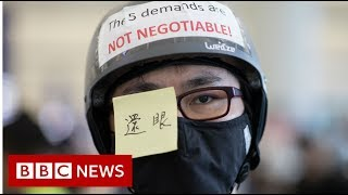 Hong Kong protests: Airport cancels flights as thousands occupy - BBC News