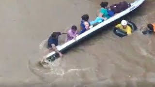 Video: Boat carrying women rescued from flood-hit areas capsizes