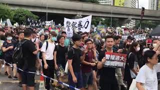 HK protesters shouting anti-police slogans during a demonstration