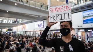 Carrie Lam warns of 'path of no return' as protesters take over airport