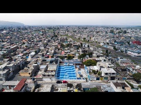 Chequered blue La Doce sports venue reinvigorates impoverished Mexico City neighbourhood