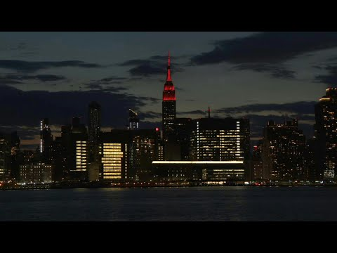 Empire state of mind: Iconic New York skyscraper shines red in tribute | AFP photo