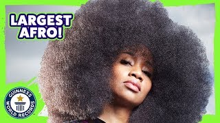 Aevin Dugas: World's largest Afro (female) - Meet The Record Breakers