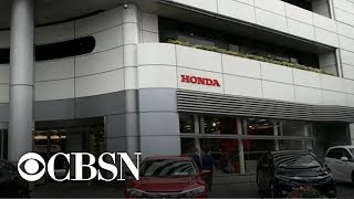MoneyWatch trends: Malaysia Airlines, Godiva sued, Honda airbag recall