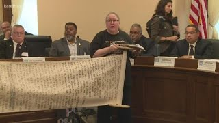 Protesters interrupt hearing on officer-involved shootings