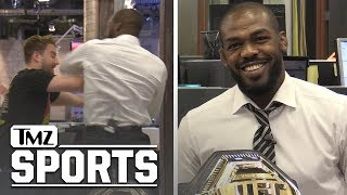 Jon Jones Talks DC, McGregor vs Khabib 2, and Tests Elbow on Staffer | TMZ SPORTS
