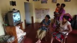 Sri Lankans watch televised Sunday mass