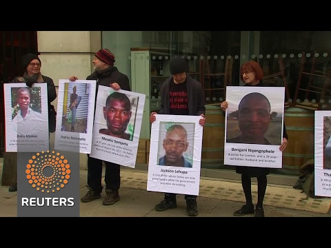 Protesters demand apology for Marikana miner massacre outside Lonmin AGM in London.