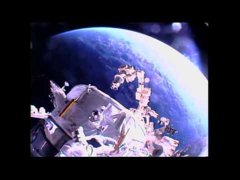 American Astronauts Install New Docking Port for U…