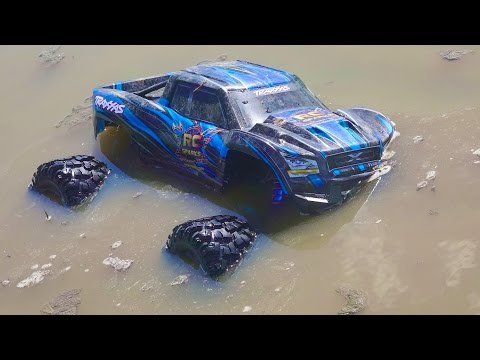 RC ADVENTURES - JUMP into THAT?! Traxxas XMAXX MT & CAT 242D Full Sized RC SKiD STEER - UCxcjVHL-2o3D6Q9esu05a1Q