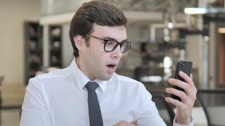 Businessman in Shock while Using Smartphone | Stock Footage - Videohive