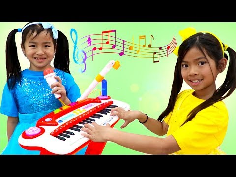Emma & Jannie Pretend Play with Guitar and Drums for Surprise Birthday Party - UCgFXm4TI8htWmCyJ6cVPG_A