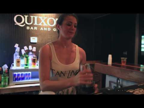 Amanda, a bartender at Quixote's, makes one of the bar's signature drinks.