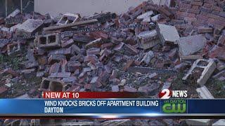 Wind knocks bricks off apartment building