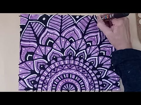 Doodling a Mandala Drawing on Painted Paper with Paint Markers