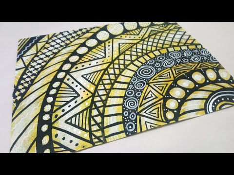 Drawing Circular Doodle Patterns on Paper with Paint Pens