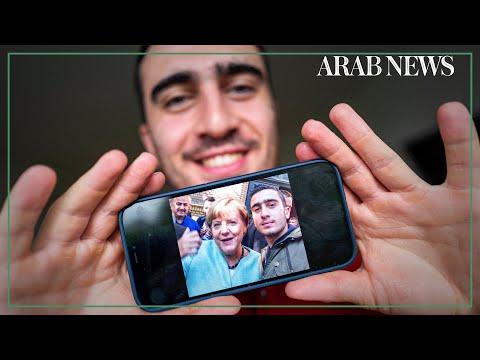 Syrian refugee reflects on life-changing Merkel selfie