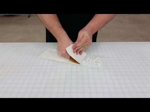 Removing Liners from Aggressive Adhesive Materials