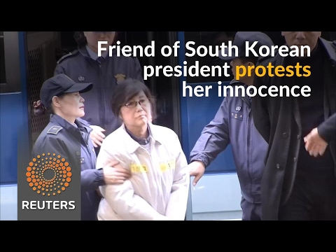 Woman at center of South Korean corruption scandal protests her innocence