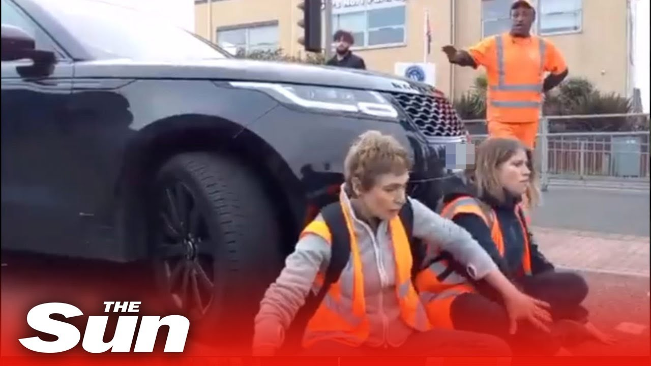 Furious motorist in drives into Insulate Britain protesters