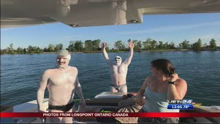 Tom and Greg Van Volkenburg swim 24 miles across Lake Erie