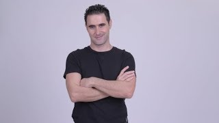 Happy Handsome Man Smiling with Arms Crossed Against White Background | Stock Footage - Videohive