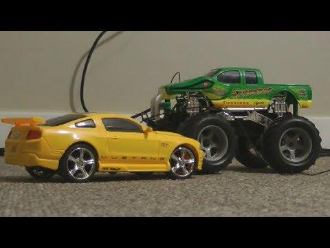 RC Monster Truck VS Yellow Ford Mustang RC TOY CARS Battles! - UCF1wvke_MJp9kd7VsXxjdkA