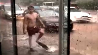 Dude wearing flippers swims in flooded streets